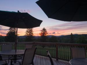 Mulligan's Pub at Windham Country Club deck and tables at sunset