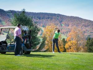 Windham Country Club golfers and golf cart