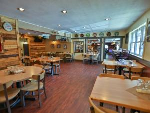 The tap room with dining tables at rip van winkle brewing company restaurant