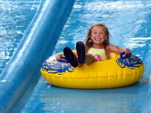 Zoom Flume Water Park girl tubing on the lazy river
