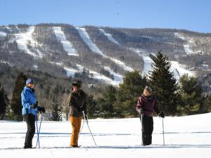 Skiiers with Windham Mountain in background
