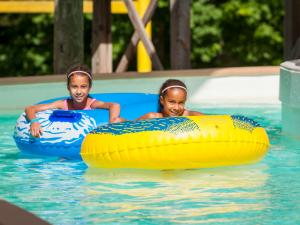Zoom Flume Water Park 2 girls tubing on the lazy river