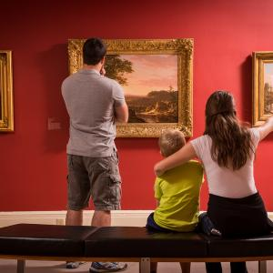 family looking at art in a museum