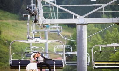 Bride and groom on a chair lift at a catskills ski resort in summer